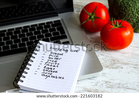 Preparing the shopping list before going to buy the groceries.  - stock photo