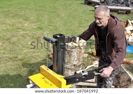Preparing the wood for the winter, splitting, betula - stock photo