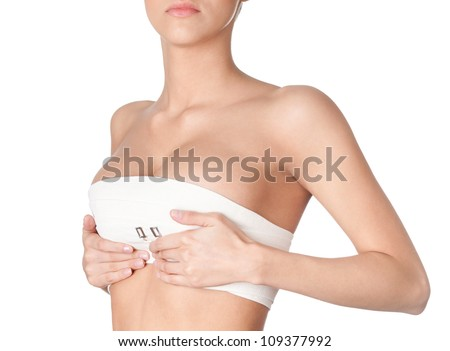 Preparing to breast correction, isolated, white background - stock photo