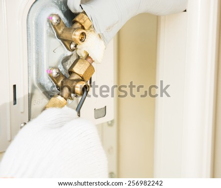 preparing to install new air conditioner and wear gloves - stock photo