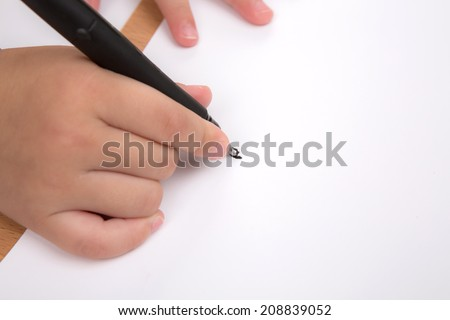 Preschool age child writing