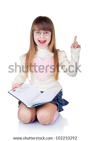 Preschool age girl wearing eyeglasses with a raised index finger isolated on white background - stock photo