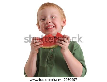 Preschool boy eating watermelon - stock photo
