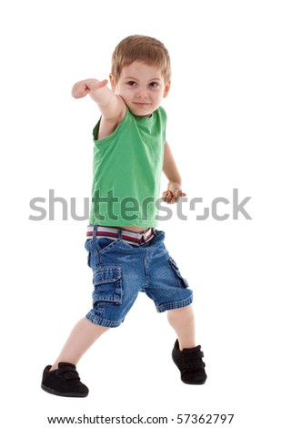 Preschool boy showing thumb up symbolizing success over white