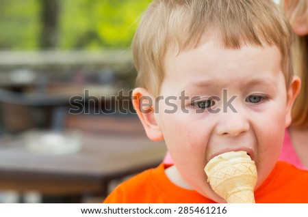preschool caucasian boy eating icecream - stock photo
