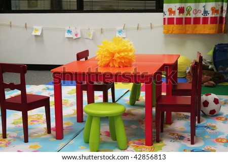 Preschool classroom with chairs and decoration - stock photo