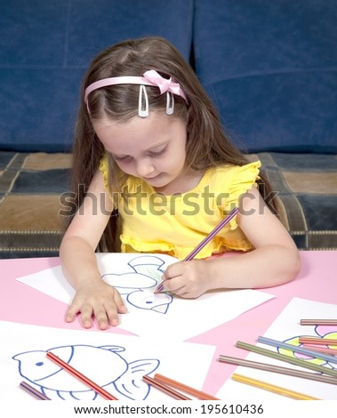 Preschool girl who color more white papers - stock photo