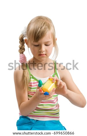 Preschool girl with finger paints on a white background, the theme of the development of creativity in children.