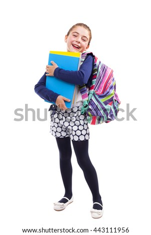 Preschool student girl carrying notebooks and backpack on white background - stock photo