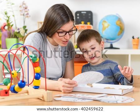 Preschool Teacher with Kid Having Creative Educational Activities - stock photo