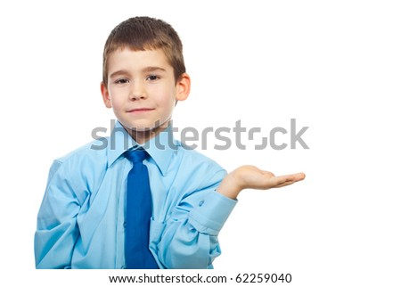 Preschooler boy standing with palm open and making presentation isolated on white background - stock photo
