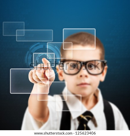 Preschooler boy touching futuristic interface - stock photo