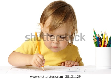Preschooler focused on her drawing, isolated over white - stock photo