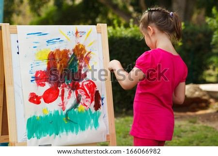 Preschooler girl Painting at the nature - stock photo