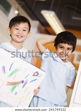 Preschoolers Holding Drawing - stock photo
