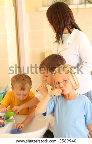 preschoolers in bathroom ready to clean teeth