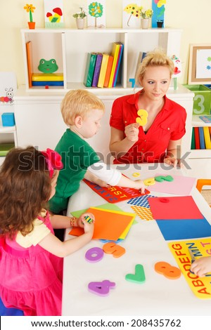 Preschoolers in the classroom working together - stock photo
