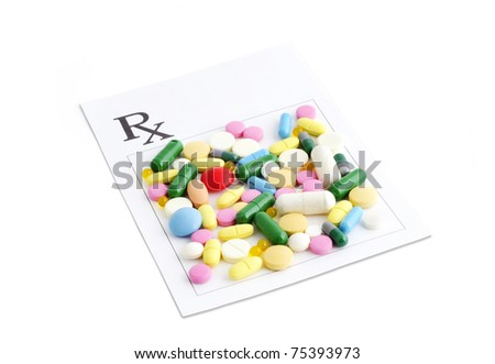 Prescription and a variety of pills and capsules on isolated white background - stock photo