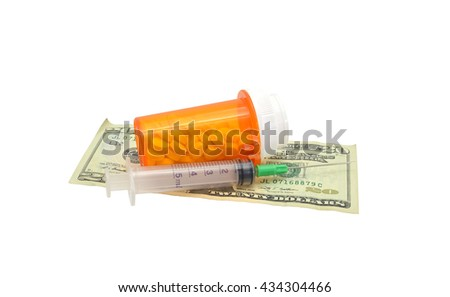 Prescription Bottle, Tablets, Needle on Twenty Dollar Bill isolated on white background