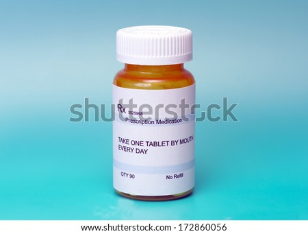 Prescription medication bottle on aqua background.  Label is not real. - stock photo