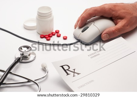 Prescription medicine and computer mouse - stock photo