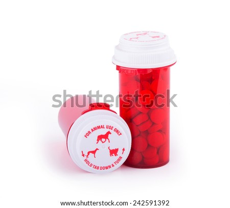 Prescription medicine for animal use in distinctive red bottles with special caps - stock photo