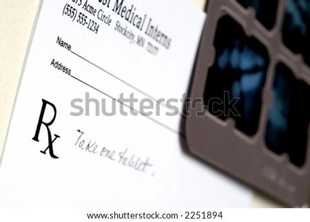 Prescription pad and X-Ray - stock photo