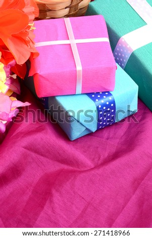 present and flower bouquet on silk, holiday wedding birthday gift box, happy mothers day