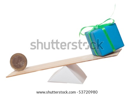 Present box balance with euro coin on white isolated background - stock photo