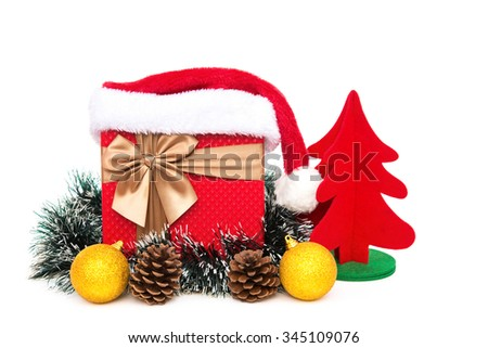 present box with christmas decoration and santa claus hat on a white background - stock photo