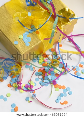 present box with colorful confetti, holiday arrangement - stock photo