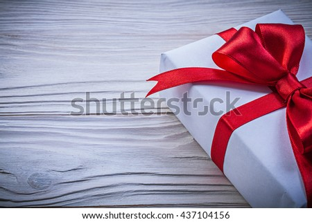 Present box with red bow directly above holidays concept. - stock photo
