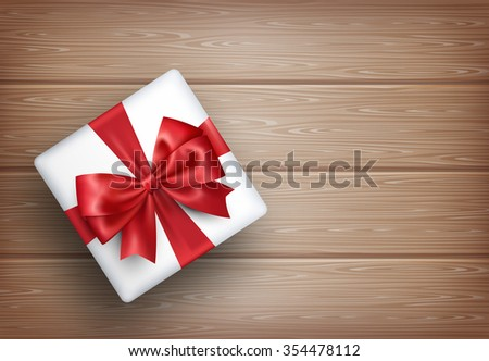 Present Gift Box with Bow on Wooden Background - stock photo