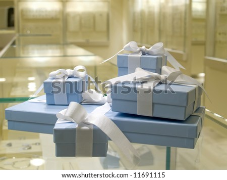Present gift in jewerly shop. Blue boxes for jewerly - stock photo
