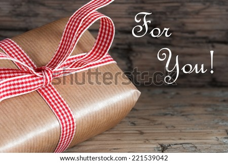 Present with Ribbon and the Words For You on Wooden Background - stock photo
