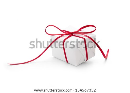 Present wrapped in white paper and tied with red ribbon
