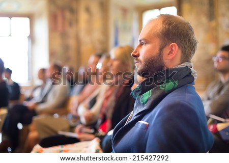 Presentation at Business Conference. Entrepreneurs in the audience at the conference hall. - stock photo