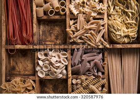 Presentation of a mix of different pastas integral stowed in small containers - stock photo