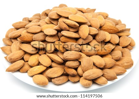 presentation of almonds peeled on a plate - stock photo