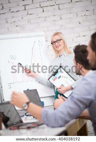 Presentation of business woman. Business people having board meeting in modern office presenting new business concept. - stock photo