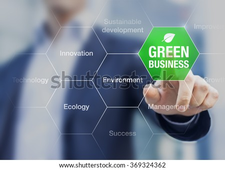 Presentation of green business concept for sustainable development with businessman in background - stock photo