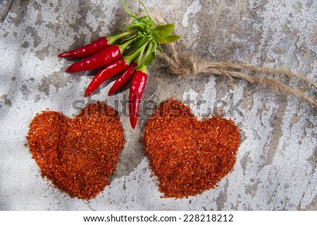 Presentation of two hearts made of chili powder  - stock photo