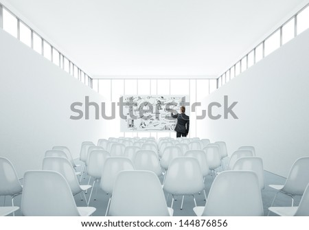 presentation room and businessman drawing strategy - stock photo
