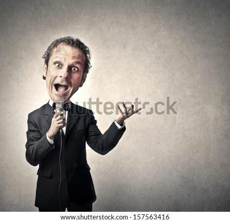 presenter announces advertising with microphone - stock photo