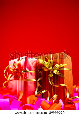 Presents in red boxes against red background