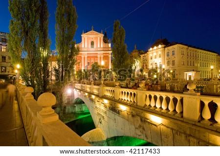 Preseren Square across Ljubljanica River at Dusk, Ljubljana, Slovenia - stock photo