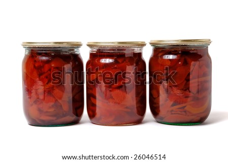 Preserve of quince jam in glass isolated on white - stock photo