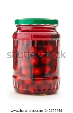 Preserved fruit, sour cherries compote in closeup - stock photo