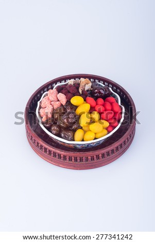 preserved fruits. chinese preserved fruits on background