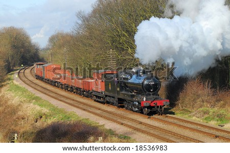 Preserved steam train on a freight service past Kinchley Lane. GCR. UK